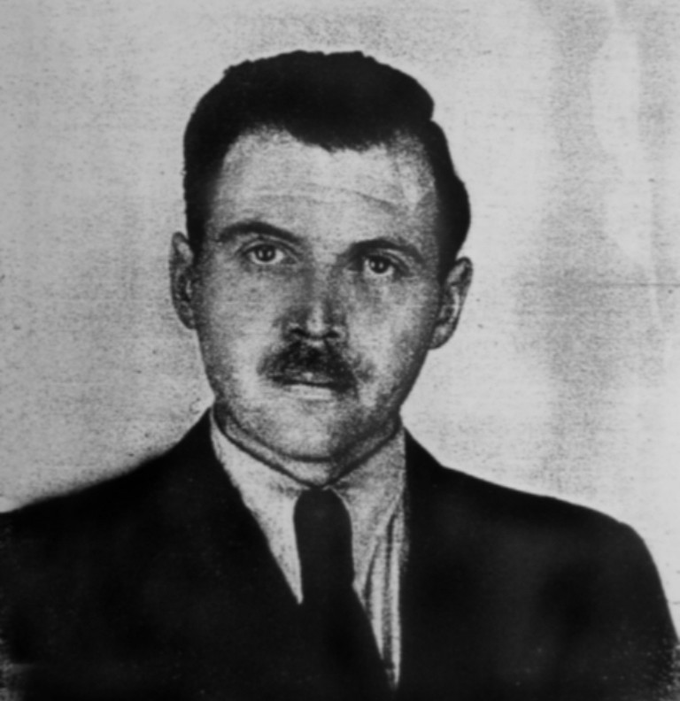 Josef Mengele (1911-1979), German SS officer. Photo taken by a police photographer in 1956 in Buenos Aires for Mengele's Argentine identification document |© Wikicommons