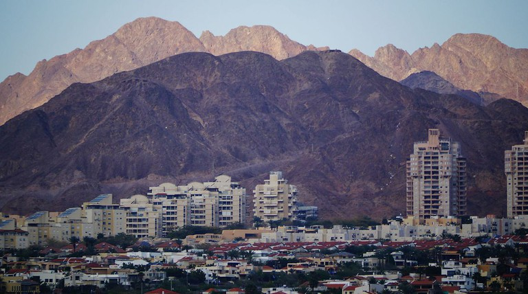 The desert mountains loom over Eilat in southern Israel