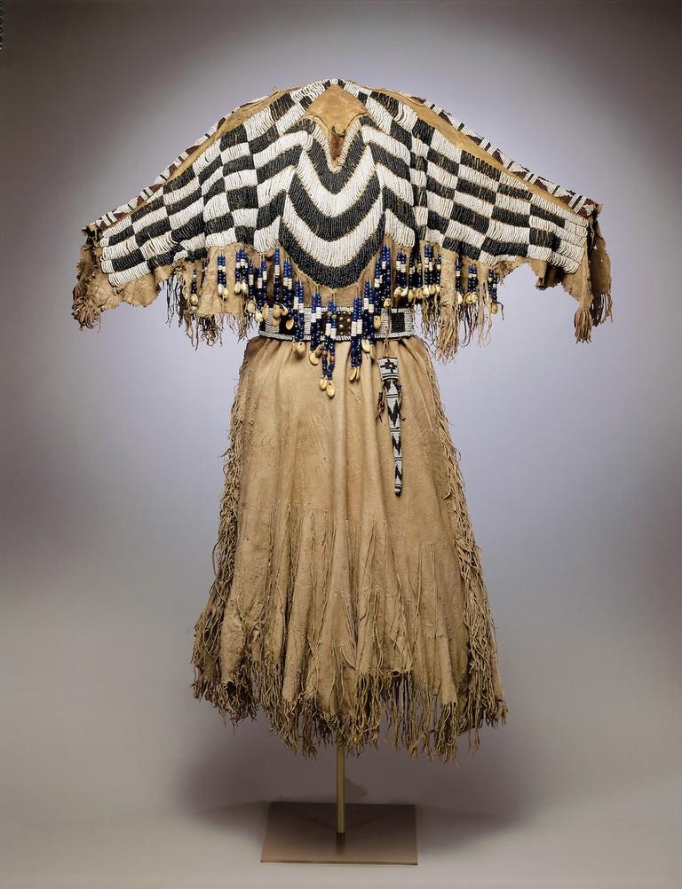 Dress and Belt with Awl Case Unrecorded Wasco Artist Wasco ca. 1870 Hide, glass, shell, bone, teeth, metal H. 52 × W. 43 1/2 in. (132.1 × 110.5 cm) Photo: Dirk Bakker
