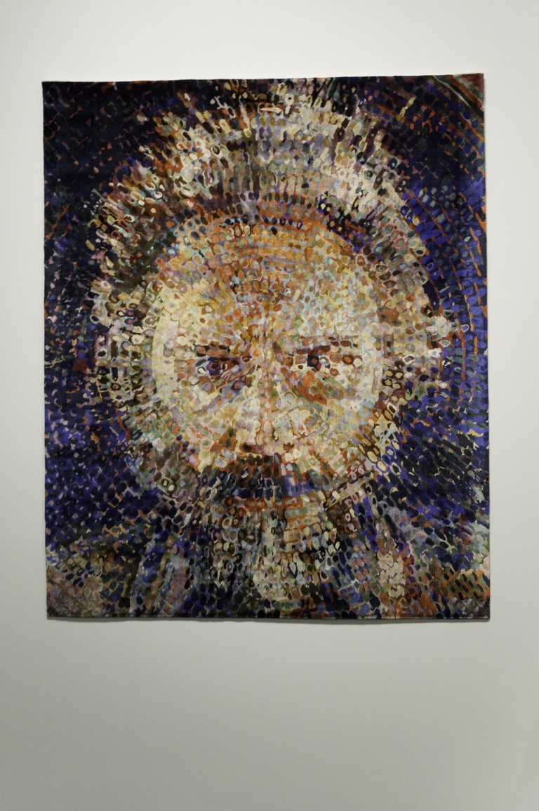 Self-portrait by Lucas Samaras in rug form