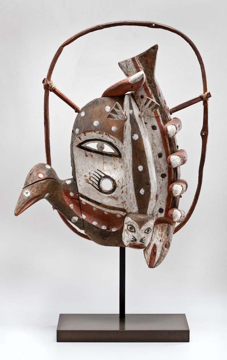 Dance Mask Unrecorded Yup'ik Artist Yup'ik ca. 1916–18 Wood, pigment, vegetal fiber H. 20 1/2 × W. 14 × D. 8 in. (52.1 × 35.6 × 20.3 cm) Photo: Dirk Bakker