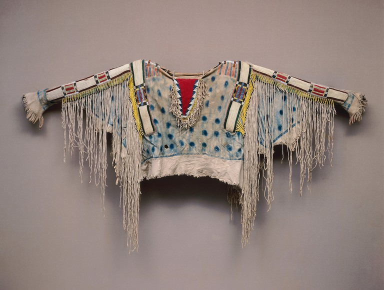 Man's Shirt Unrecorded Niimiipu (Nez Perce) Artist Niimiipu (Nez Perce) ca. 1850 Hide, quill, horsehair, sinew, wool, glass, pigment H. 32 11/16 × W. 60 11/16 in. (83 × 154.1 cm) Photo: Dirk Bakker