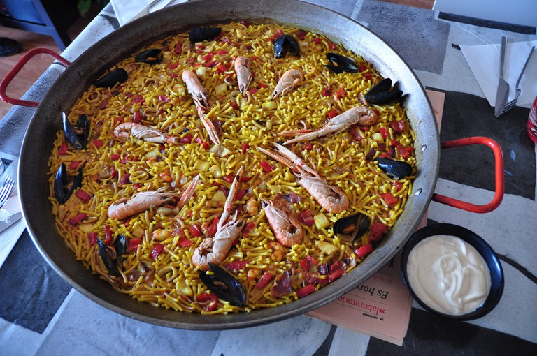 """<a href=""""https://www.flickr.com/photos/xurde/4736096800/in/photolist-cryvHJ-8dvJzo-928VTf""""><i>Fideuà</i>, a dish made with noodles and seafood   © Jorge Diaz/Flickr</a>"""