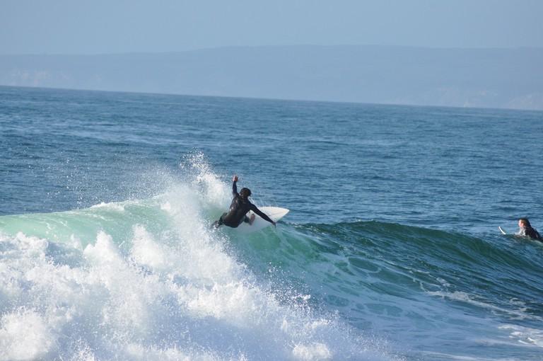 Catching waves at Punta de Lobos, Pichilemu