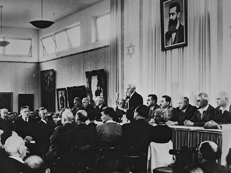 David Ben Gurion flanked by the members of his provisional government reading the Declaration of Independence in the Tel Aviv Museum Hall on May 14, 1948 | GPO, Flickr