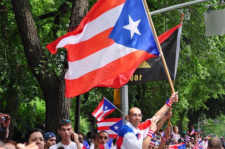 Attendees at a Puerto Rican Day parade | © Juan Beltran / Flickr