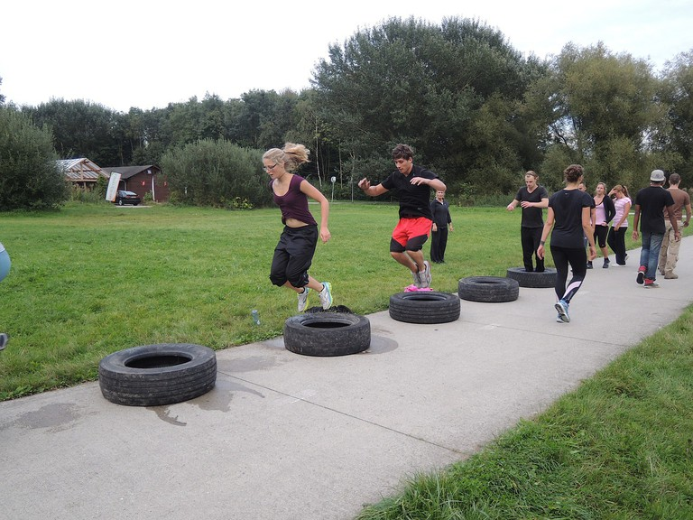 People exercise at a bootcamp