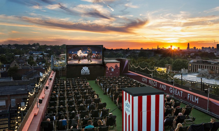 Rooftop Cinema Film Club at sunset | Courtesy of Belt and Braces PR at Bussey Building, Peckham