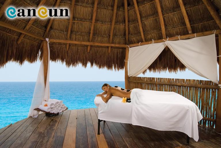 Beachfront terrace | Courtesy of Cancun.Travel