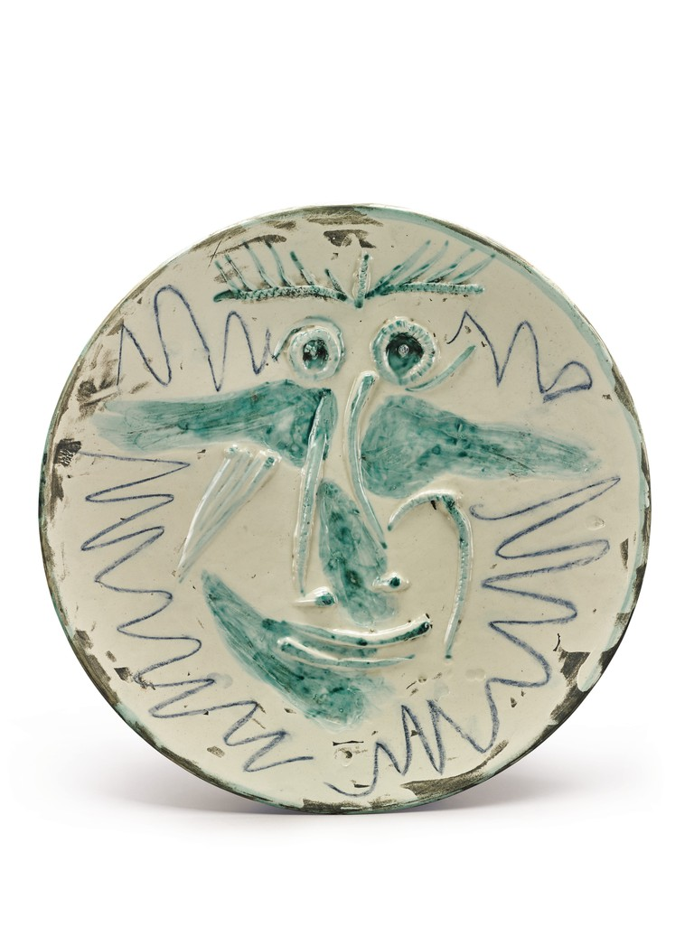 Visage Dated 6.10.60 and stamped Madoura plein feu and Emprienteoriginale de Picasso (on the reverse)Painted and partially glazed ceramic; large round plate Diameter: 16¾ in.; 42.5 cm Executed on October 6, 1960; this is a unique version of the empreinte.Estimate: $40/60,000