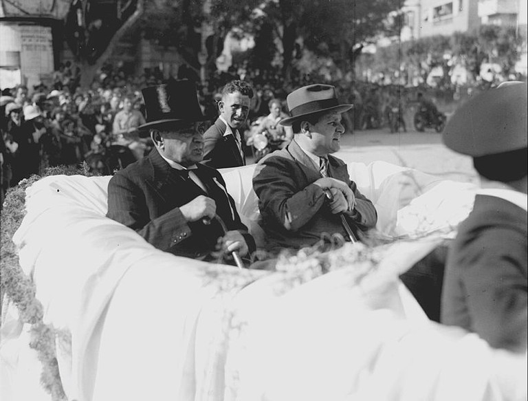 Meir Dizengoff rides in a car at the head of Tel Aviv's Purim Parade in 1935 | Zoltan Kluger (1896 – 1977), Wikimedia Commons
