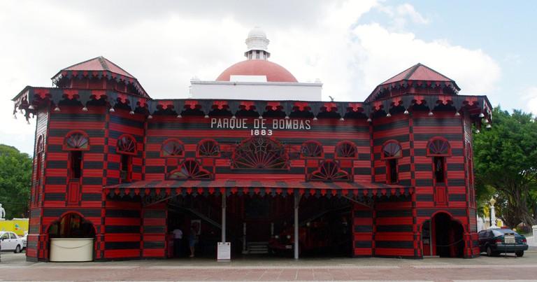 "<a href=""https://www.flickr.com/photos/kjfnjy/8378007759/in/photolist-7ZD7ce-6NCwSu-6NymMT-6NymXH-dLktPD-dpyHa8-65xrgM-mJvPCQ-kszwUX-4CSfFS"">Old Ponce Fire Station, Parque de Bombas | © Ken & Nyetta/Flickr</a>"