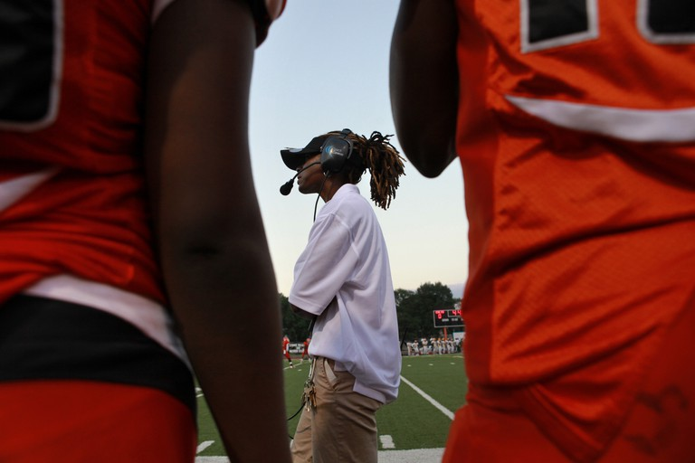 Mandatory Credit: Photo by Jacquelyn Martin/AP/REX/Shutterstock (6304902c) Natalie Randolph Natalie Randolph, the head football coach at Coolidge Senior High School, watches her team play during her first game as head coach at home against Archbishop Carroll, in Washington D.C. Randolph is a novelty as a female high school football coach. She's also quickly become a winning football coach Female Coach Turkey Bowl Football, Washington, USA