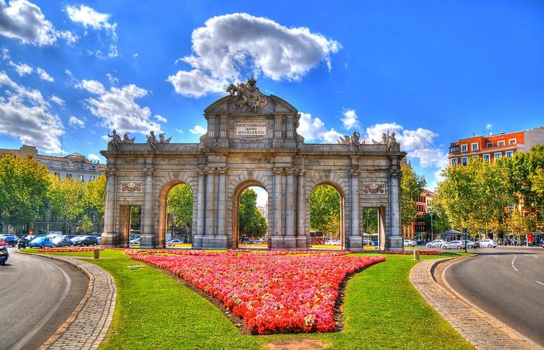 "<a href=""https://www.shutterstock.com/image-photo/colorful-image-puerta-de-alcala-gate-330096227?src=5thK2t_dEIkD9zaZYQzsWA-1-20"">The Puerta de Alcalá © The World in HDR/Shutterstock</a>"