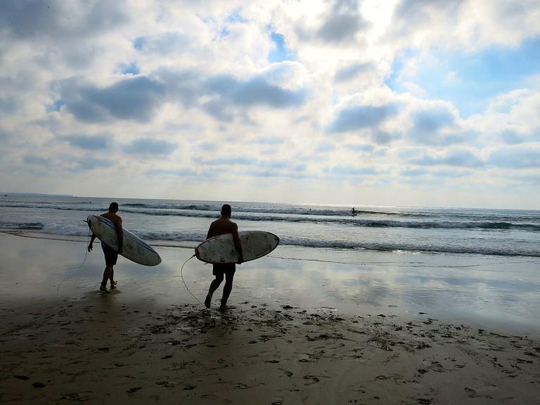 Surfers at Praia da Arrifana