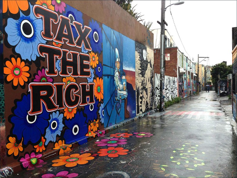 """""""Tax The Rich"""" mural by Megan Wilson on Clarion Alley San Francisco"""