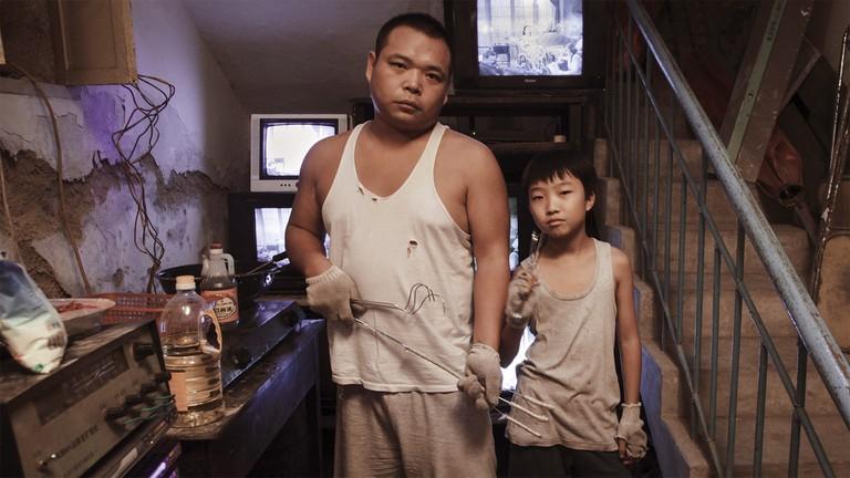 Zhao Jun and Wang Naixun in 'King of Peking'