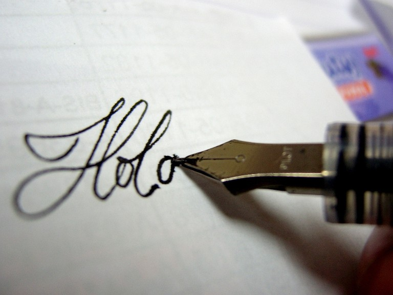"""The word """"hola"""" which means """"hello"""" in Spanish 