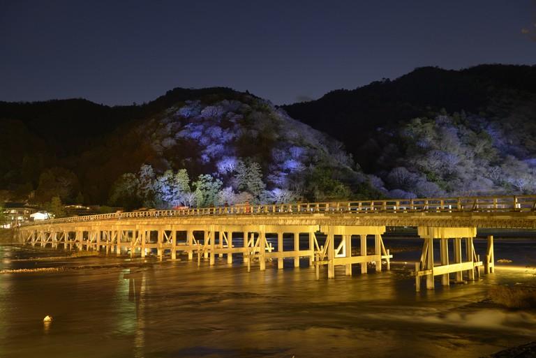Mooning Crossing Bridge