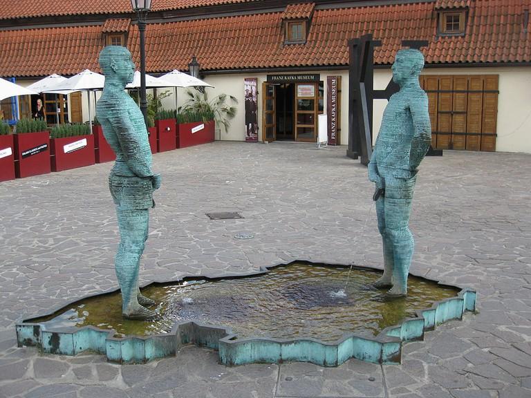 Peeing statues outside the Kafka Museum