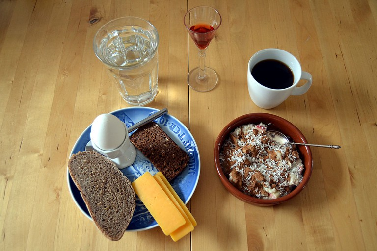 Soft-boiled eggs, bread, cheddar and oatmeal with sloe schnapps and coffee