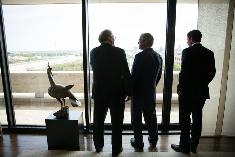 At left, Tom Johnson, Chairman Emeritus of the LBJ Foundation, shows the Austin skyline to former President George W. Bush