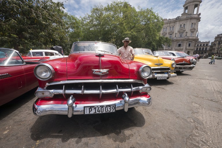 Old cars parked at Parque Central, Havana