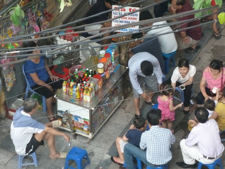 Vietnamese local people gather on the pavement for chit-chat