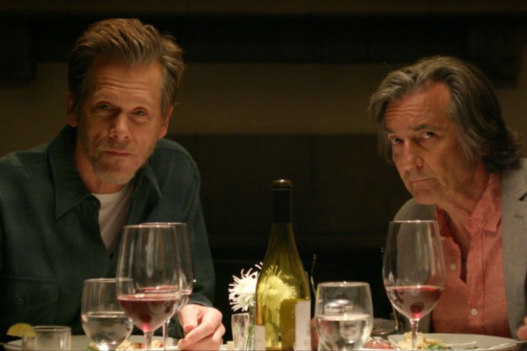 Dick (Kevin Bacon) and Sylvère (Griffin Dunne)