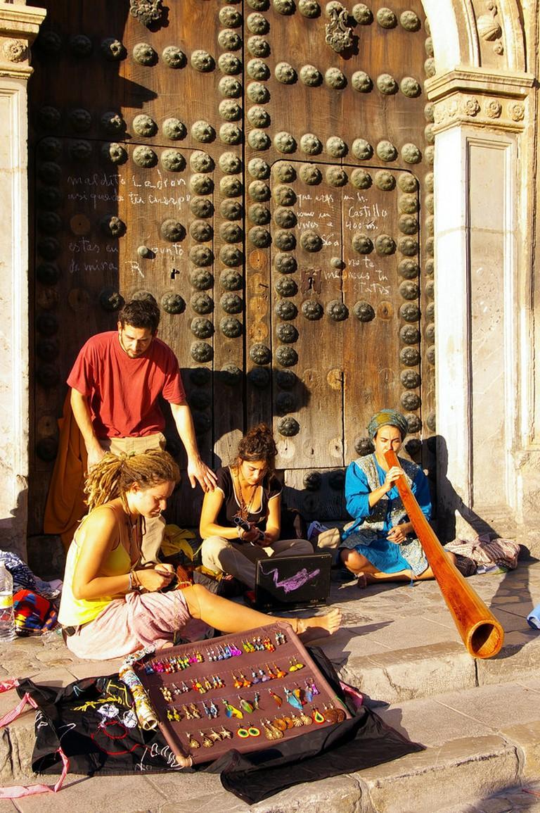 Hippies selling handmade jewelry in Granada