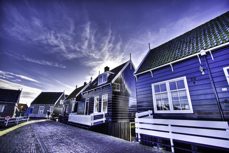 A row of brightly painted houses in Marken