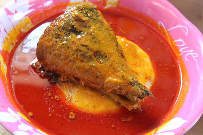 Fufu with palm nut soup and fish