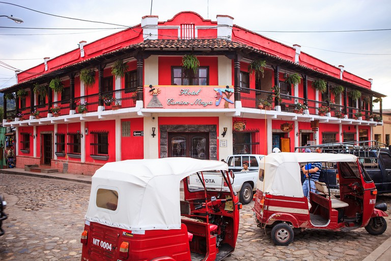 Bright red Guatemala, blending in with the transport
