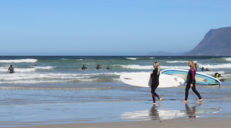 Surfers at Muizenberg Beach