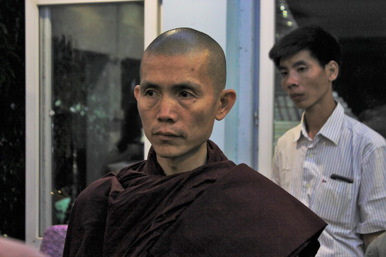 Ottamasara listens to a follower after a late night Dhamma talk