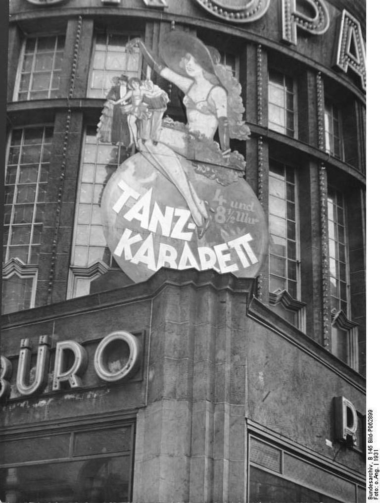 "<a href=""https://en.wikipedia.org/wiki/File:Bundesarchiv_B_145_Bild-P062899,_Berlin,_Tanzkabarett_im_Europahaus.jpg"">The Europahaus, one of hundreds of cabarets in Weimar Berlin, 1931   © Wikimedia Commons</a>"