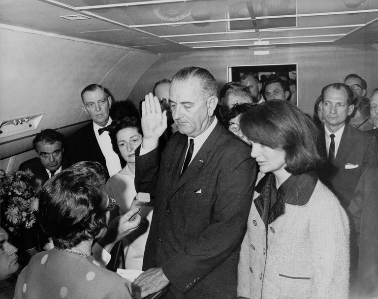 Cecil Stoughton's iconic photograph of Lyndon B. Johnson taking the oath of office as President following the assassination John F. Kennedy.