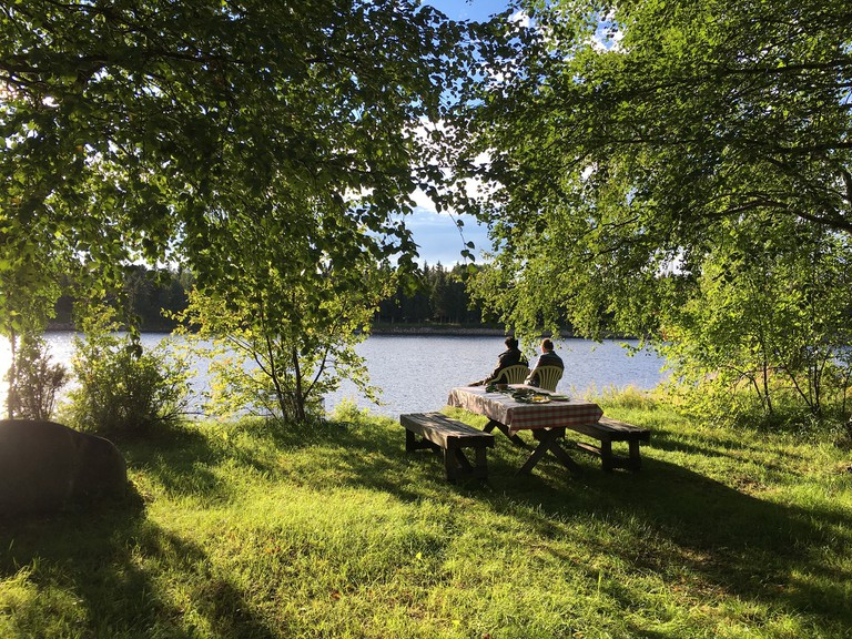 Relaxing by a Finnish lakeside