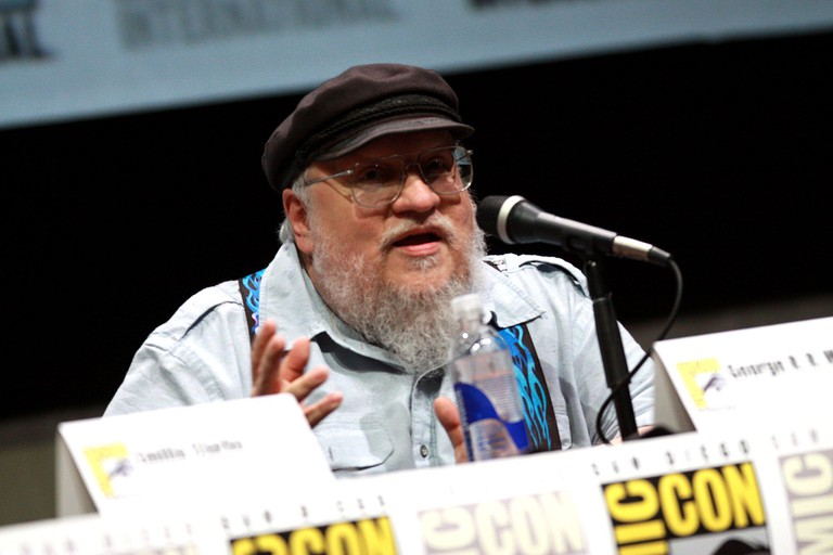 """<a href=""""https://commons.wikimedia.org/wiki/File%3AGeorge_R._R._Martin_by_Gage_Skidmore.jpg"""">George R.R. Martin   © Gage Skidmore/WikiCommons</a>"""