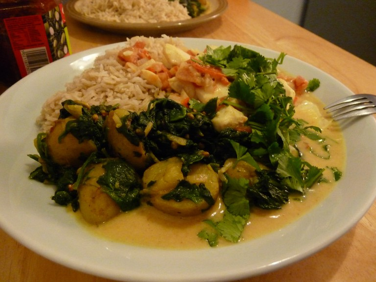 Goan fish curry, aloo saag and rice