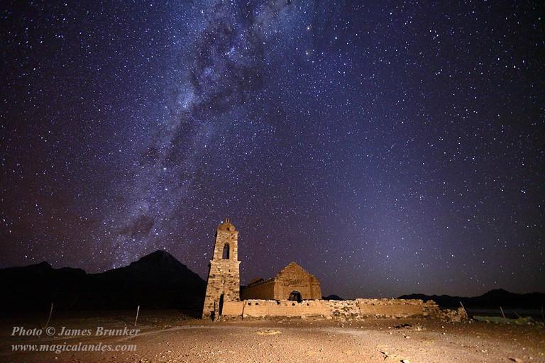 Milky Way and Zodiacal Light above ruined church at Huacolle and Sajama volcano, Sajama National Park, Bolivia