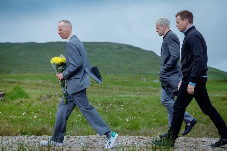 T2Spud (Ewen Bremner), Simon 'Sickboy' (Jonny Lee Miller) and Mark Renton (Ewan McGregor) walking in the great outdoors