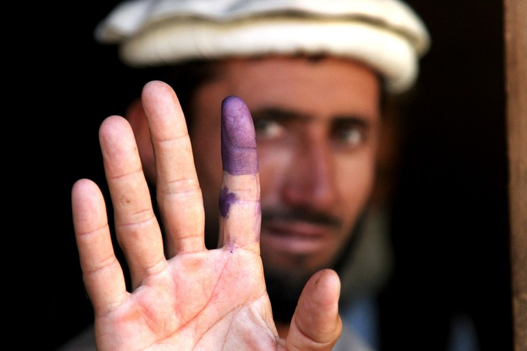 """<a href=""""https://commons.wikimedia.org/wiki/File%3AInked_finger.jpg"""">Indelible ink 
