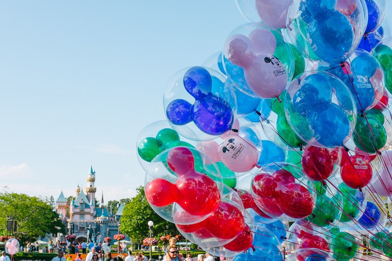 Mickey Balloon Bouquet In Front Of Cinderella's Castle