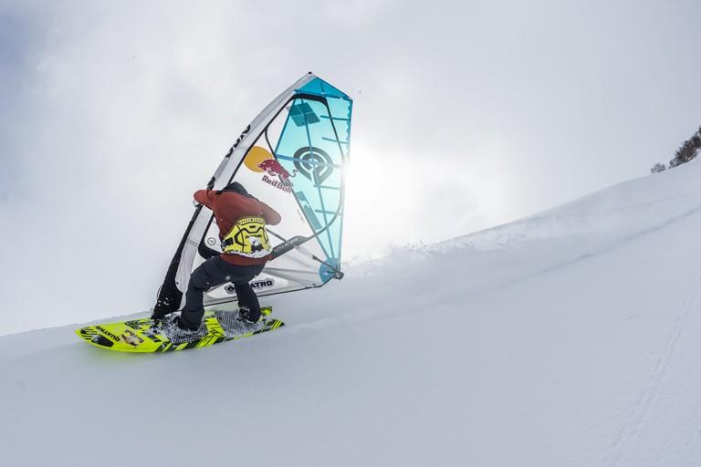 Siver rides his board down Rishiri Mountain.