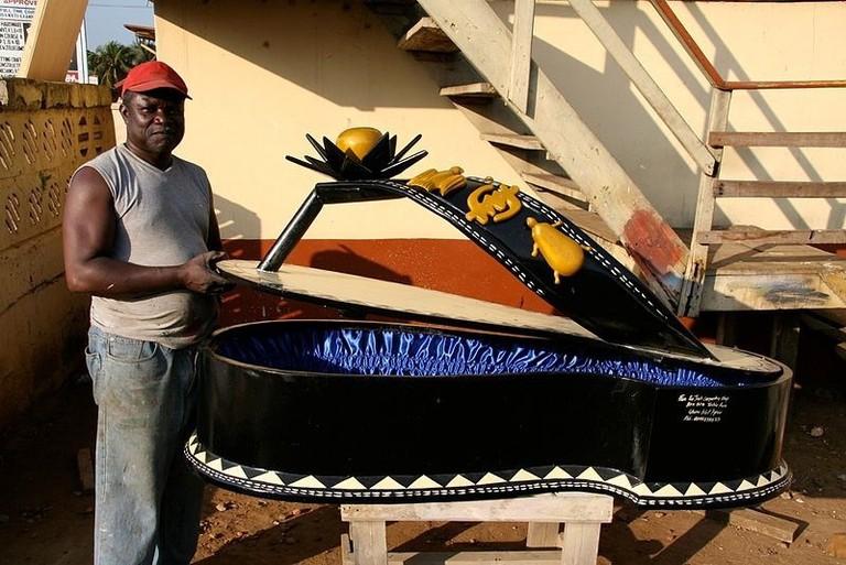 Paa Joe inspecting his Ahenema sandal coffin