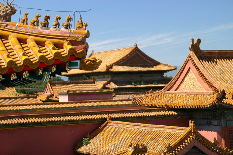 The yellow roofs of the Palace Building