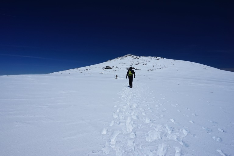 Hiking up the mountain's southern slopes with the summit in view; Encarni Novillo