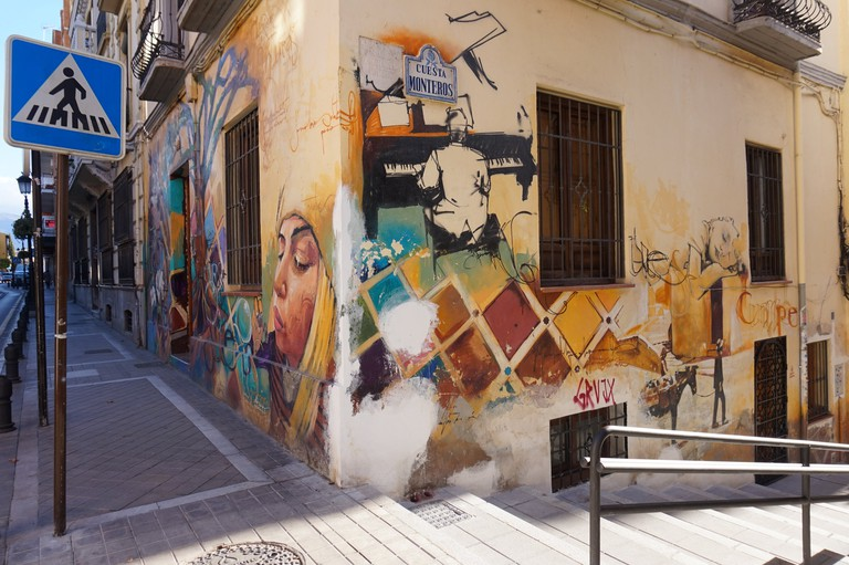 An otherwise unremarkable building transformed by street art in Granada