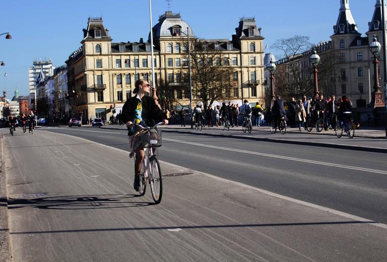 Biking along Nørrebro Lakes in Copenhagen